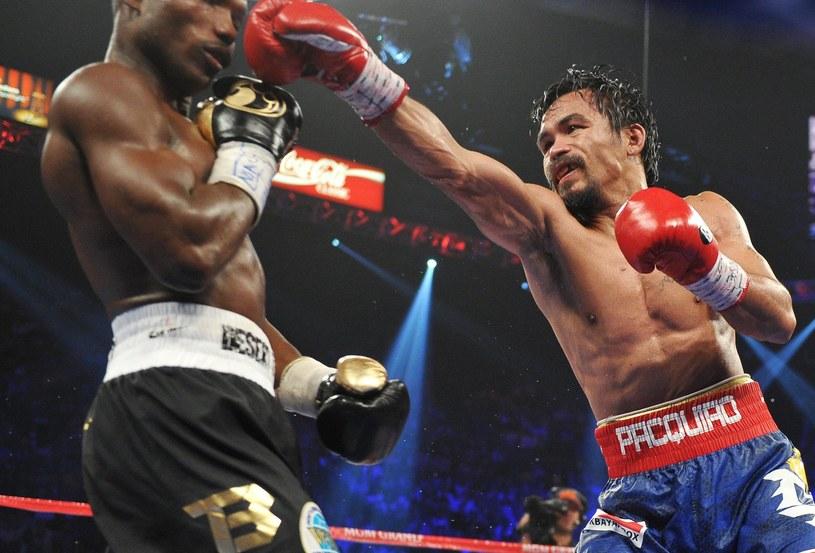Manny Pacquiao (z prawej) podczas ostatniej walki z Timothym Bradley'em /AFP