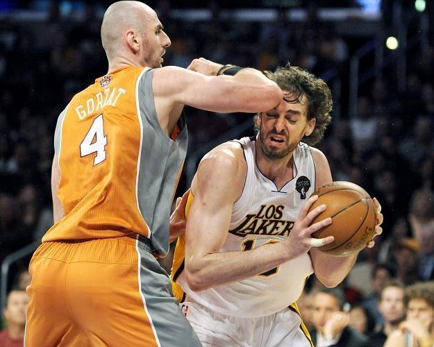 Marcin Gortat po starciu z kolegą z Phoenix Suns złamał nos /PAP/EPA