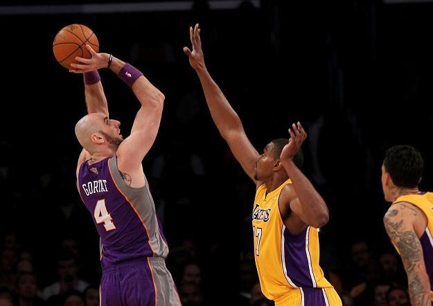 Marcin Gortat zdobył 14 punktów w meczu z Los Angeles Lakers /AFP