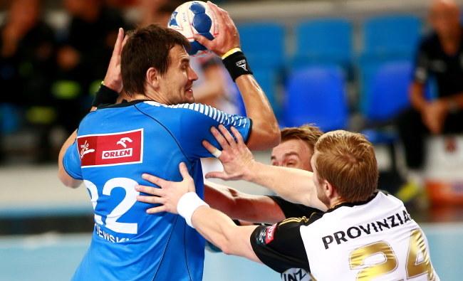Marcin Lijewski (z piłką), gracz Orlenu Wisły Płock /Marcin Bednarski /PAP