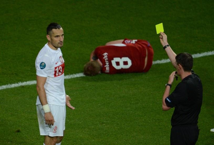 Marcin Wasilewski (z lewej) podczas meczu Euro 2012 z Czechami /AFP