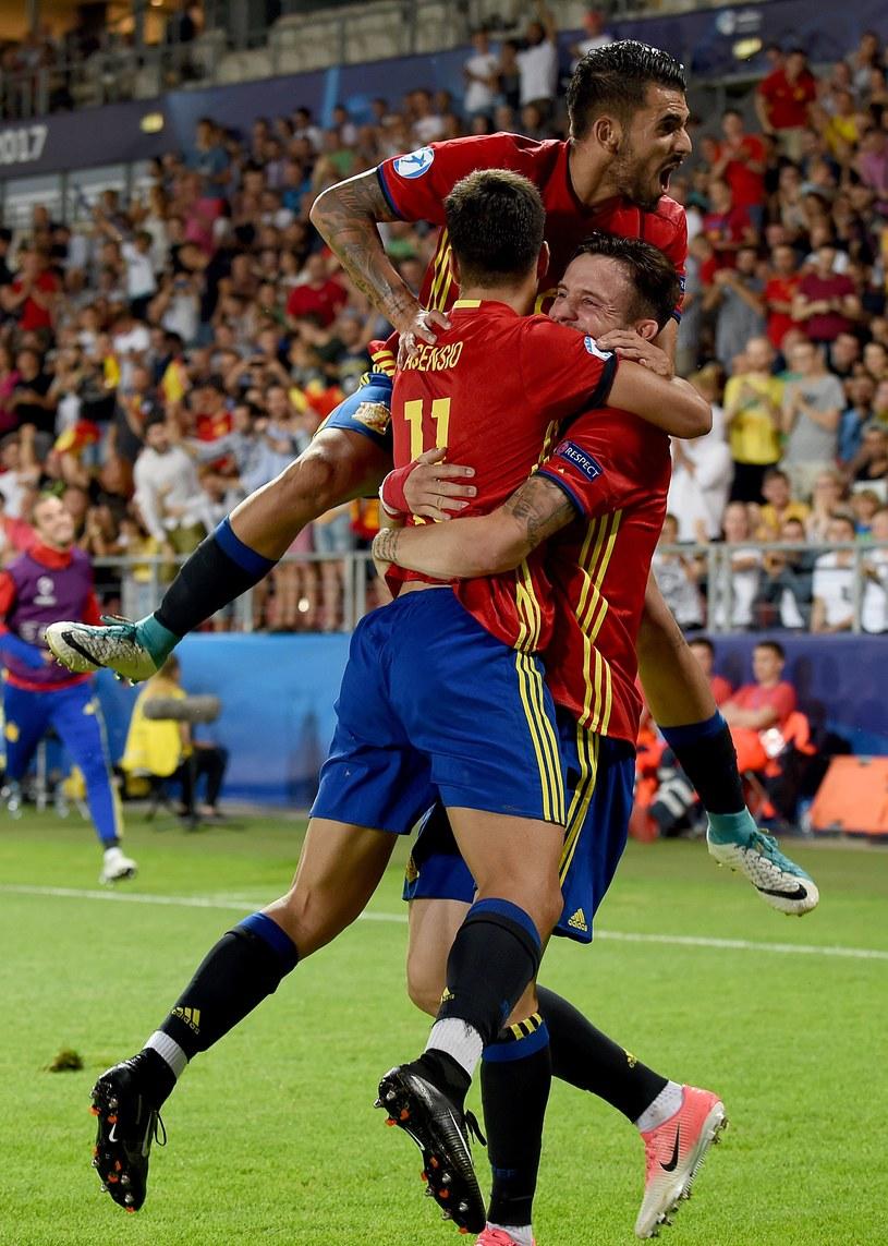 Marco Asensio w ramionach Saula Nigueza, na górze Dani Ceballos /AFP
