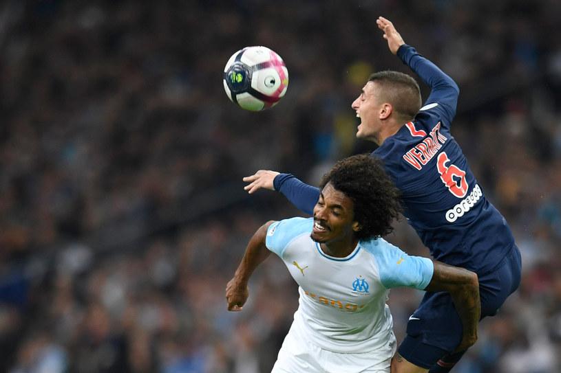 Marco Verratti w walce z Luizem Gustavo w Ligue 1 /AFP