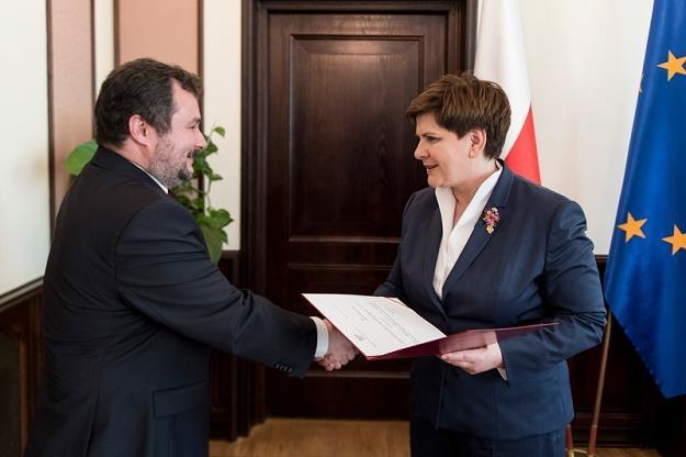 Marek Niechiał i Beata Szydło /fot. P. Tracz, źródło: www.uokik.gov.pl /PAP