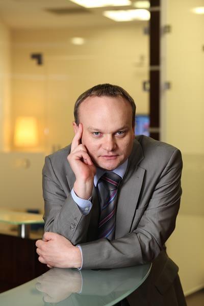 Marek Wołos, ekonomista /