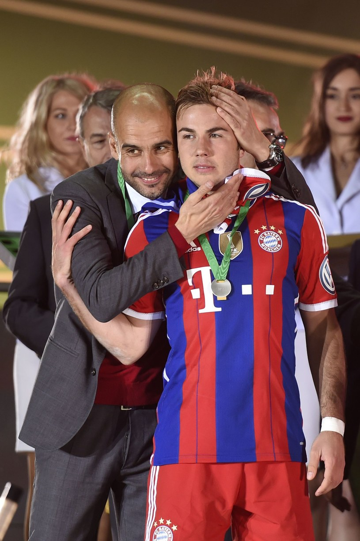 Mario Goetze i trener Bayernu Pep Guardiola /AFP