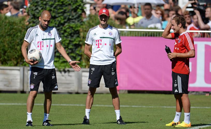 Mario Goetze (z prawej) oraz trener Bayernu Pep Guardiola (z lewej) /AFP