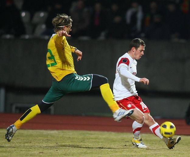 Marius Stankevicius (z lewej) i Ludovic Obraniak. /AFP