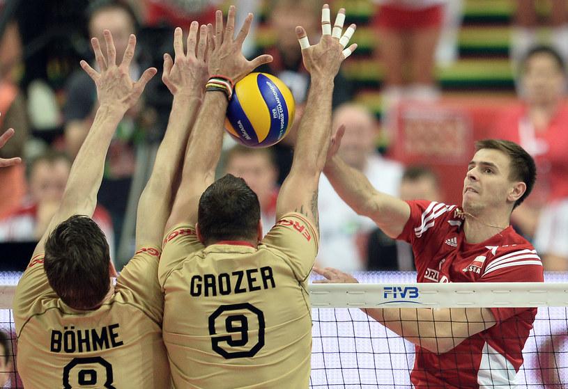 Mariusz Wlazły (z prawej) w meczu z Niemcami /Janek Skarżyński /AFP