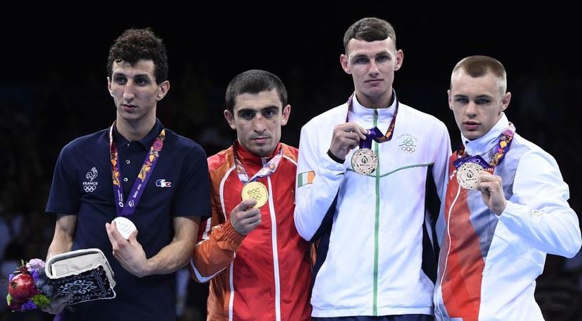 Mateusz Polski (pierwszy z prawej) /AFP
