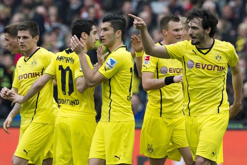 Mats Hummels (z prawej) świetnie czuje się w Borussii Dortmund /AFP