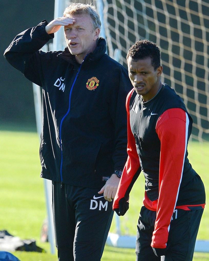 Menedżer Manchesteru United David Moyes (z lewej) i Nani /AFP