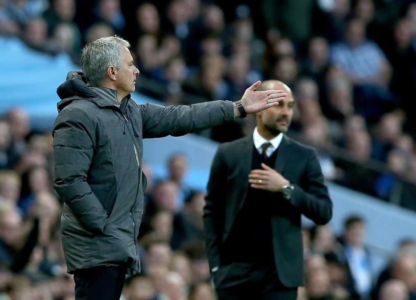 Menedżerowie klubów z Manchesteru - Pep Guardiola (City; z prawej) oraz Jose Mourinho (United) /PAP/EPA