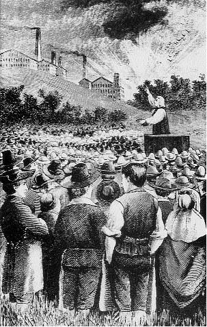 Metodysta John Wesley głosi przebudzenie wiary w jednym z angielskich miast /Encyklopedia Internautica