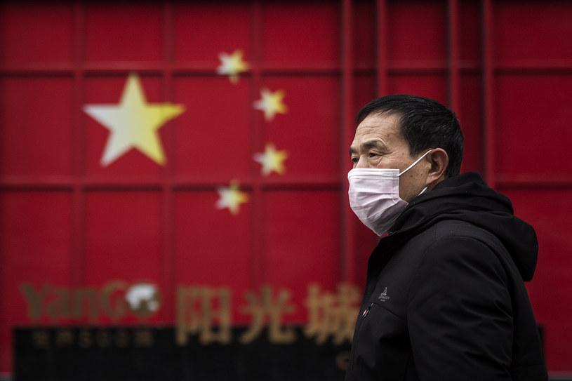 Mężczyzna na ulicy Wuhanu. Zdjęcie ilustracyjne /Getty Images