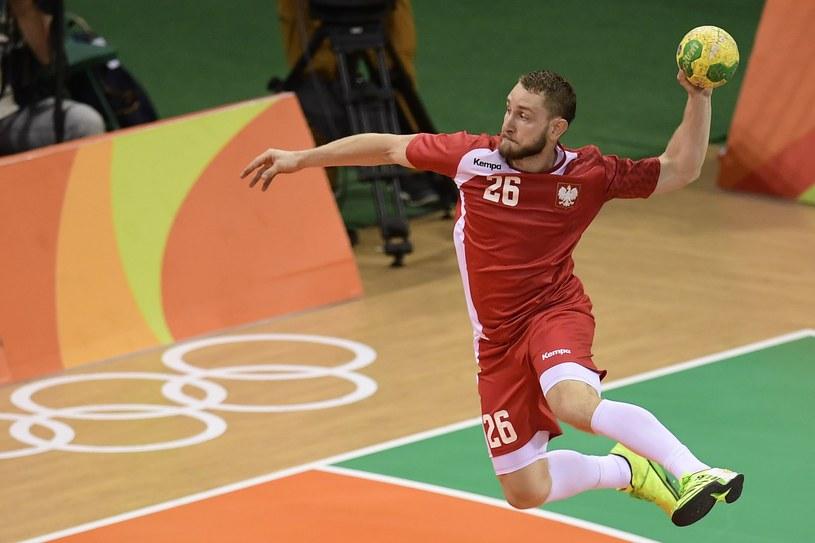 Michał Daszek w meczu z Danią /AFP