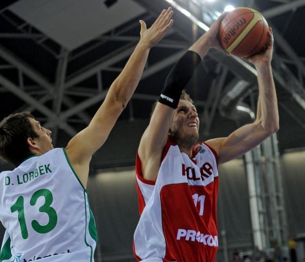 Michał Ignerski (z piłką) /AFP