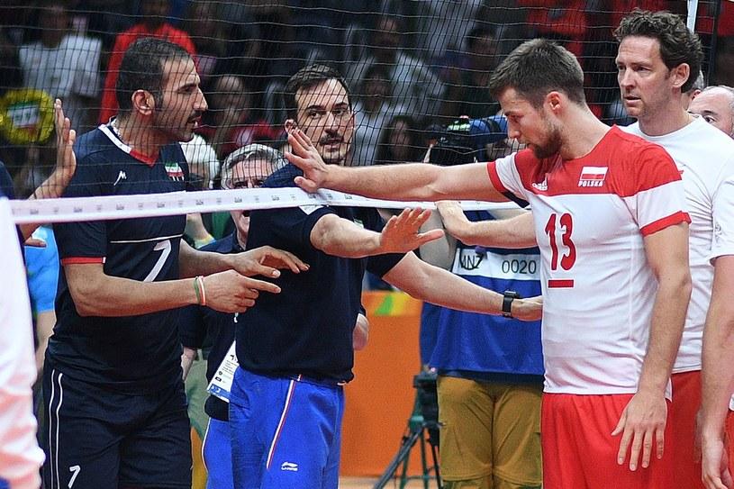 Michał Kubiak (z prawej) po meczu z Iranem w czasie igrzysk olimpijskich w Rio de Janeiro /JOHANNES EISELE /AFP