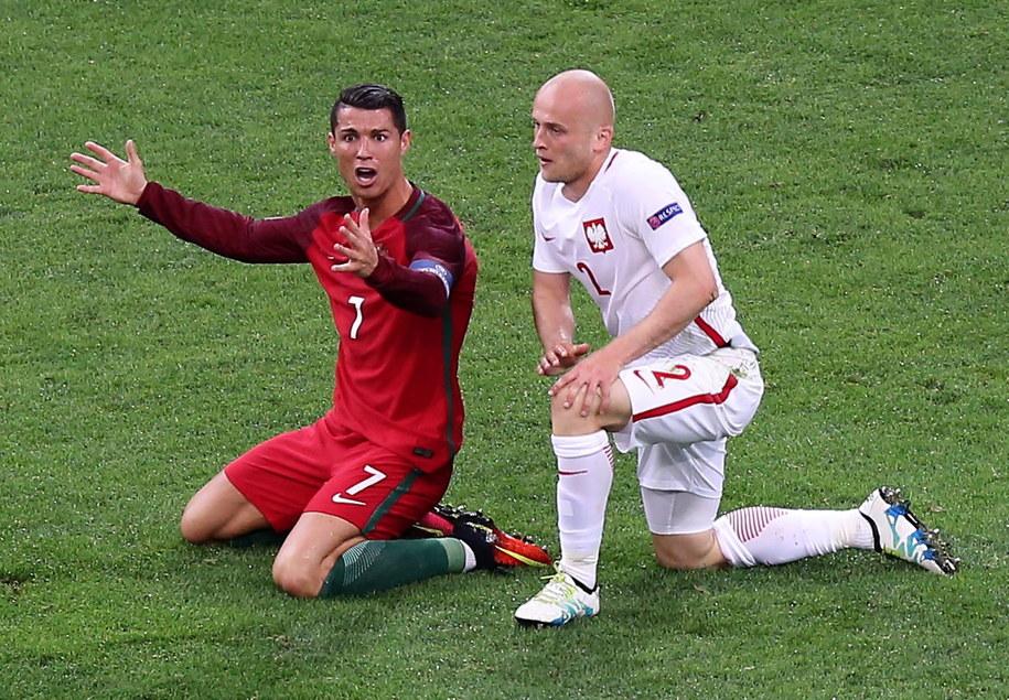 Michał Pazdan i Christian Ronaldo /MOHAMED MESSARA /PAP/EPA