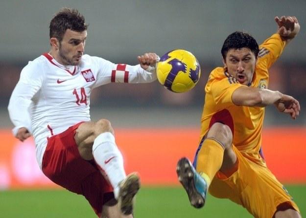 Michał Żewłakow w meczu Polska - Rumunia /AFP