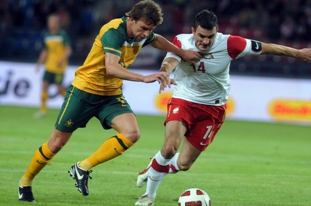 Michał Żewłakow (z prawej) za oceanem zagrał 100. i 101. mecz w kadrze /AFP
