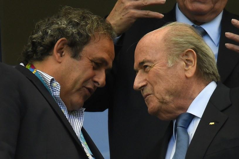 Michel Platini, szef UEFA (z lewej), oraz Sepp Blatter, sternik FIFA /AFP