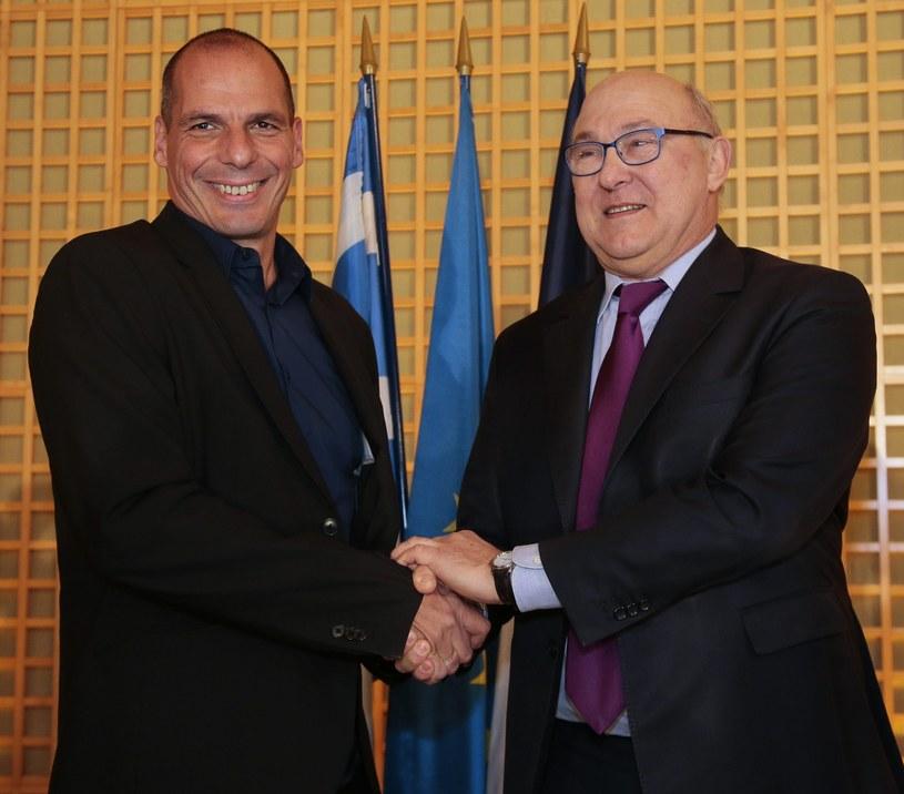 Michel Sapin (z prawej) spotkał się z Janisem Warufakisem /AFP