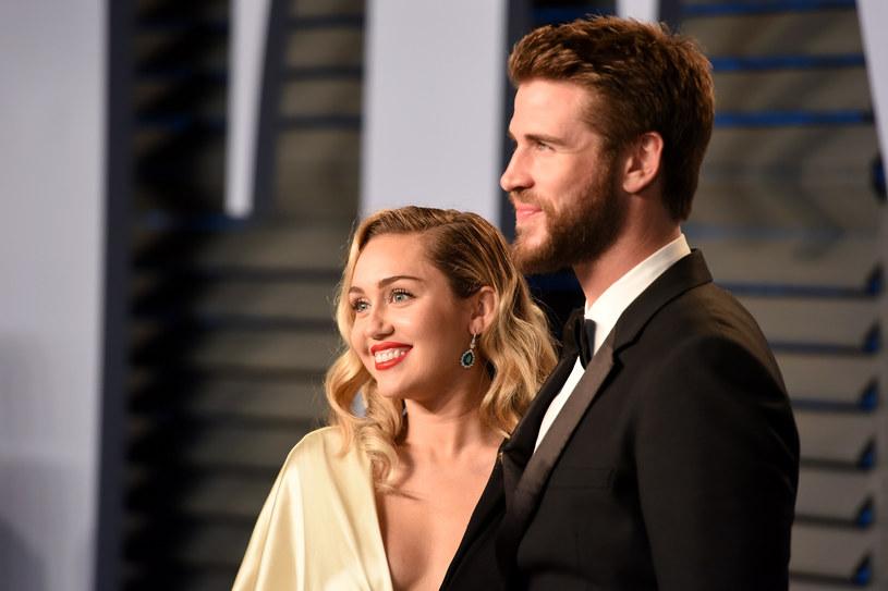 Miley Cyrus i Liam Hemsworth /Presley Ann /Getty Images