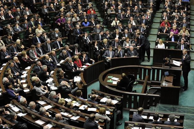 Minister sprawiedliwości Krzysztof Kwiatkowski na mównicy, przed głosowaniem, fot. Paweł Kula /PAP