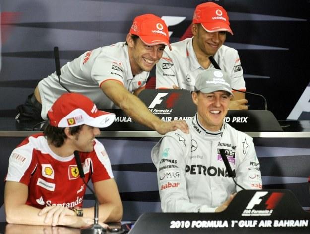 Mistrzowie w komplecie: Button i Hamilton (górny rząd) oraz Alonso i Schumacher /AFP