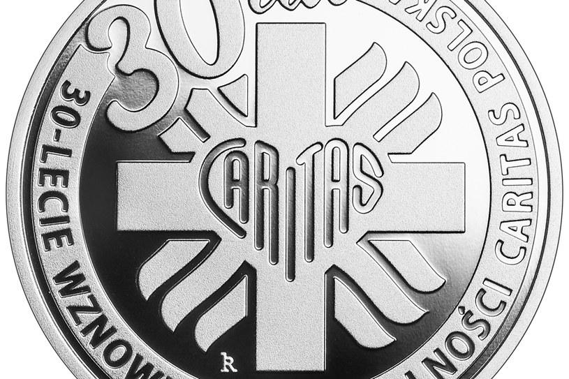 Moneta kolekcjonerska NBP: 30-lecie wznowienia działalności Caritas Polska, 10 zł, detal rewersu /NBP