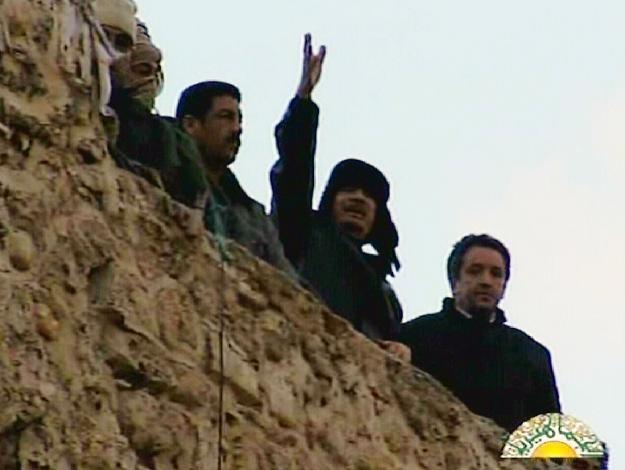 Muammar Kadafi podczas piątkowego przemówienia /AFP