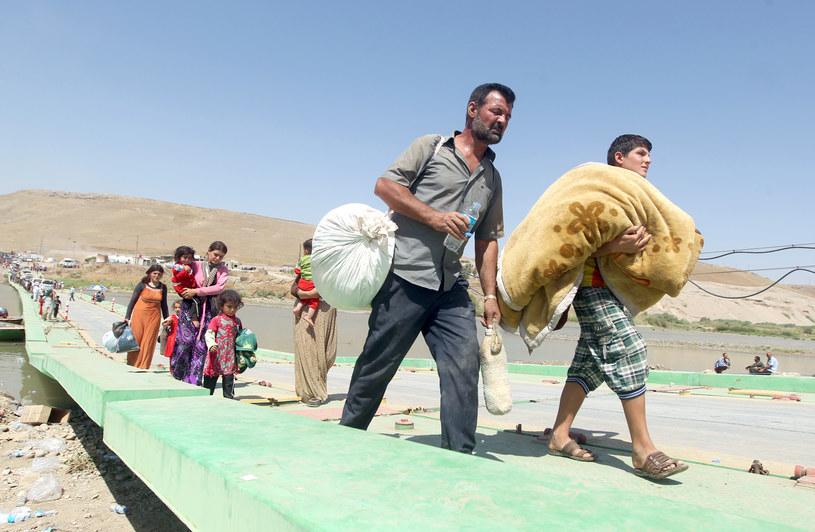 Na zdjęciu Jazydzi uciekający przed zbrodniarzami z Państwa Islamskiego /AFP