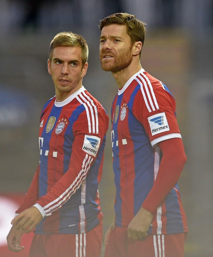 Na zdjęciu z lewej Philipp Lahm i Xabi Alonso z prawej /Bernd Feil /East News