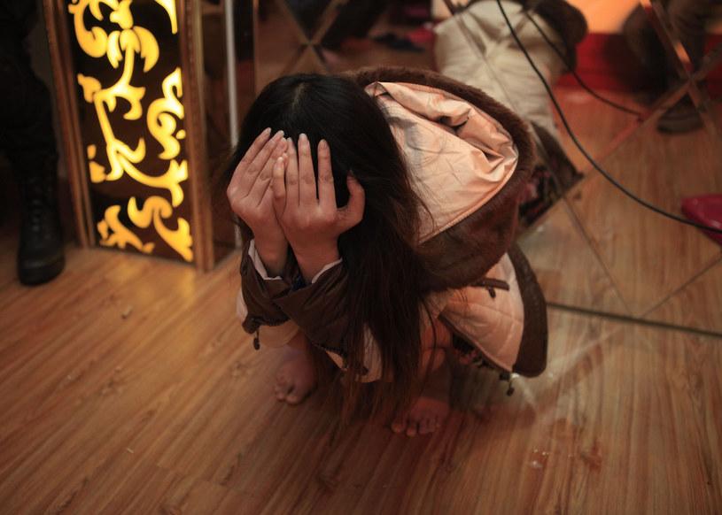 Na zdjęciu zatrzymana w trakcie akcji chińskiej policji kobieta /AFP /AFP