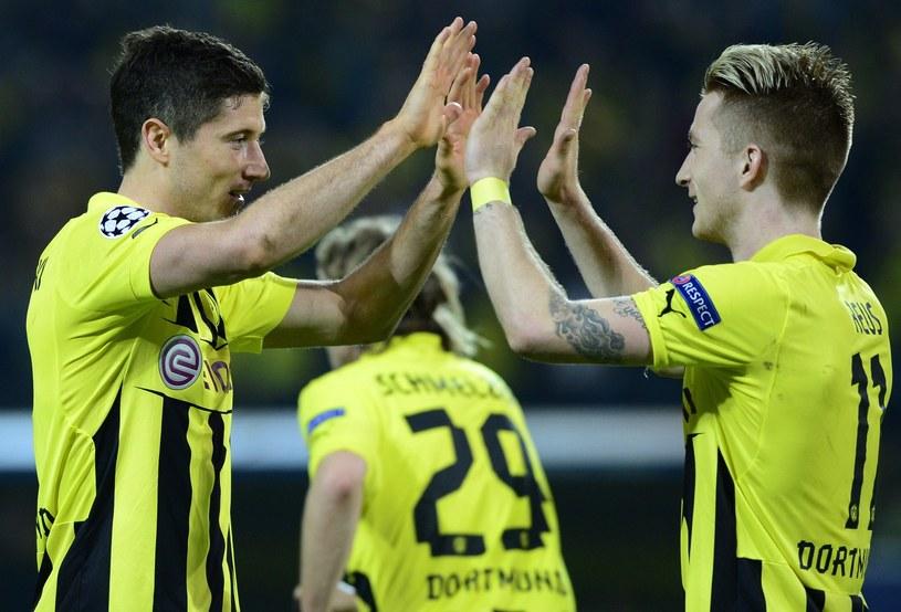 Największe gwiazdy Borussii Dortmund w minionym sezonie - Robert Lewandowski (z lewej) i Marco Reus /AFP