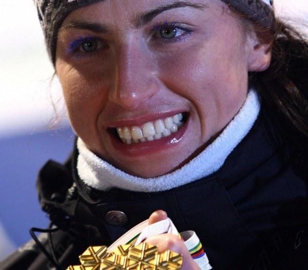 Nasza złota Justyna Kowalczyk. /AFP