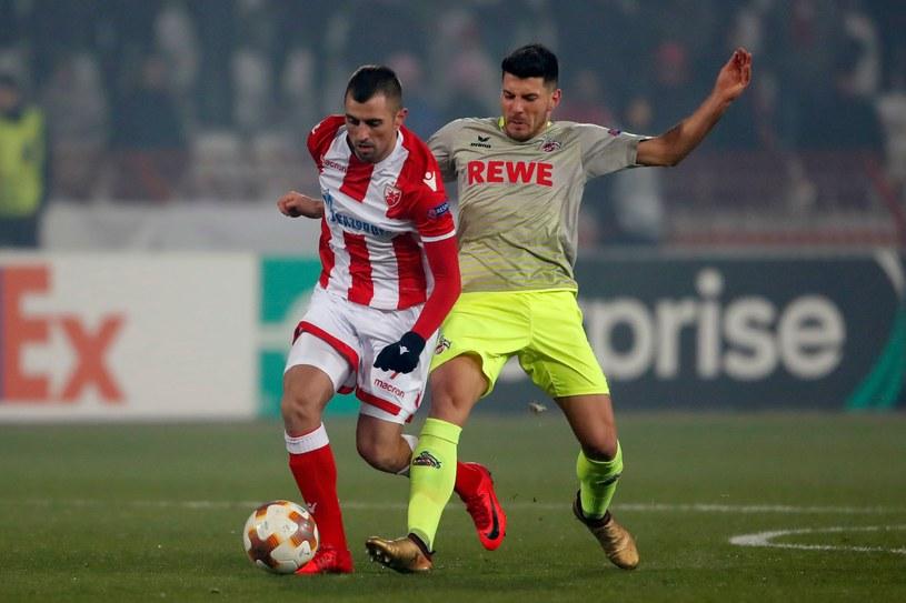 Nenad Krsticzić (L) z Crveny Zvezda i Milosz Jojić z FC Koeln /AFP