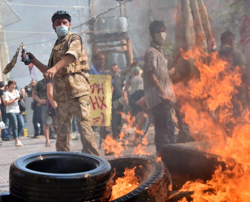 Nie obyło się bez bójek, płonęły opony /AFP