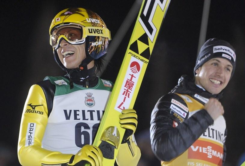 Noriaki Kasai (z lewej) i Simon Ammann /AFP