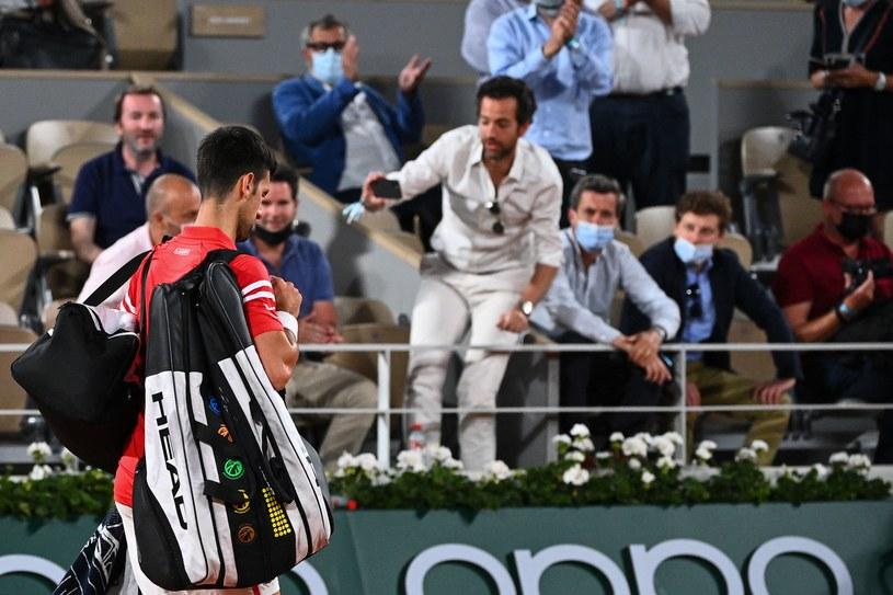 Novak Djoković opuszczający kort / AFP/AFP ANNE-CHRISTINE POUJOULAT/ /AFP