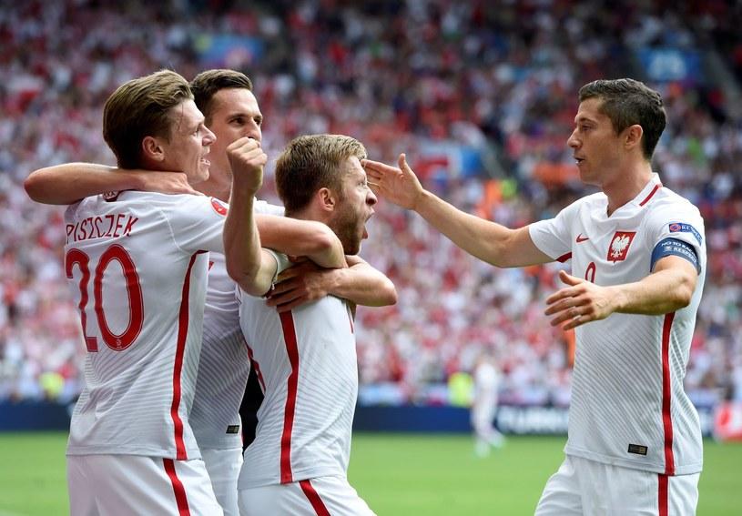 O ile dla Kuby Błaszczykowskiego (w środku) sezon był nieudany, o tyle Łukasz Piszczek (1.  lewej) i Robert Lewandowski (z prawej) triumfowali. /AFP