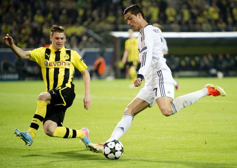 Obrońca Borussii Dortmund - Łukasz Piszczek i gwiazda Realu Madryt Cristiano Ronaldo /AFP