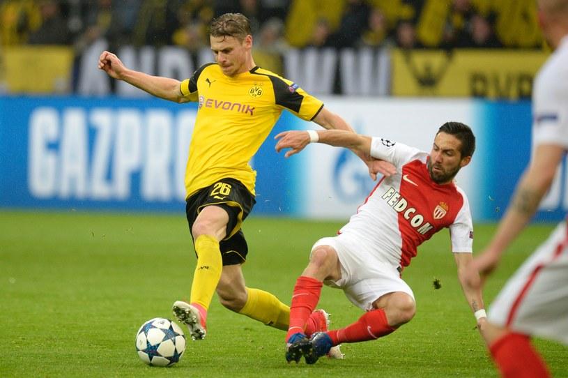 Obrońca Borussii Dortmund Łukasz Piszczek (z lewej) w meczu z AS Monaco /AFP