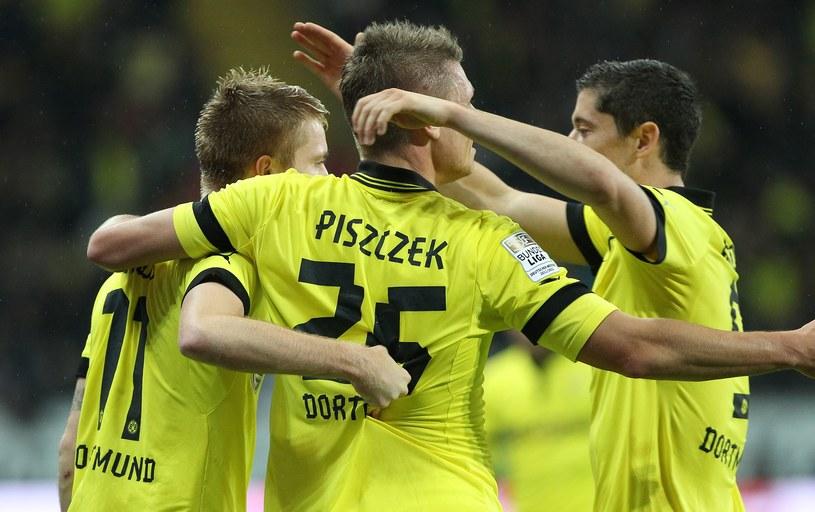 Od lewej: Marco Reus, Łukasz Piszczek i Robert Lewandowski z Borussii Dortmund /AFP