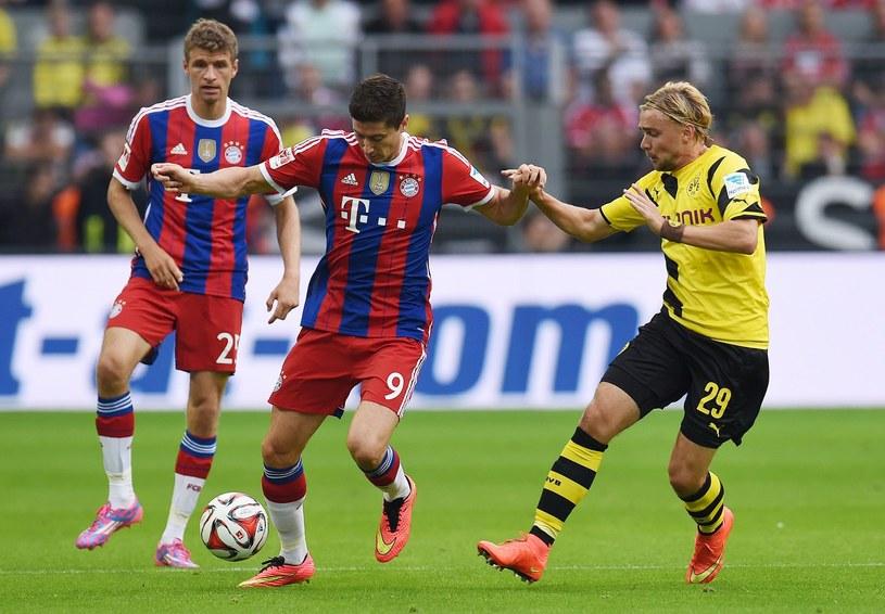 Od lewej: Mueller, Lewandowski i Schmelzer w meczu o Superpuchar Niemiec /AFP