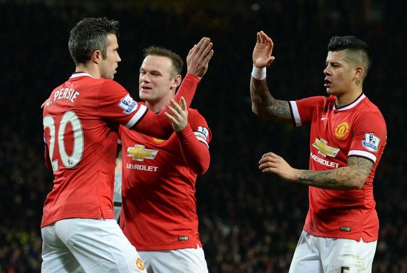 Od lewej: Robin van Persie, Wayne Rooney i Marcos Rojo /AFP
