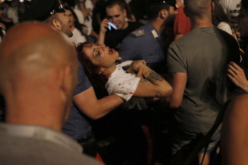 Około 600 osób odniosło obrażenia w sobotę na centralnym placu w Turynie /MARCO BERTORELLO /AFP