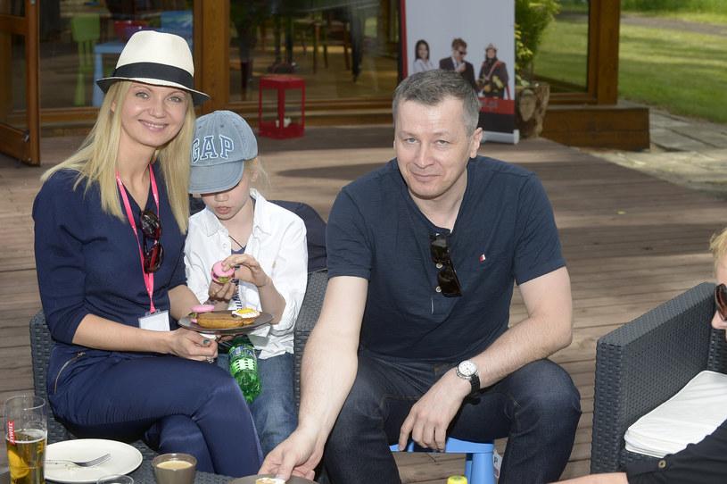 Olga Borys i Wojciech Majchrzak z córką /Gałązka /AKPA