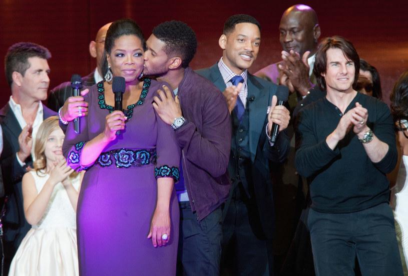 Oprah Winfrey w otoczeniu gwiazd. U boku królowej telewizji: Simon Cowell, Jackie Evancho, Usher, Will Smith, Michael Jordan i Tom Cruise (2011) /Daniel Boczarski /Getty Images